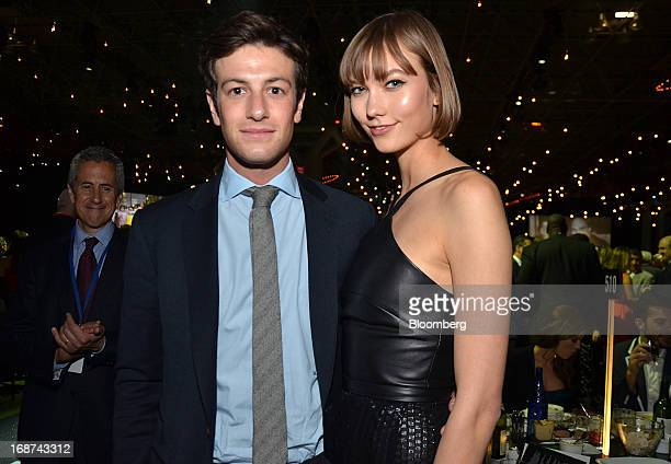 Joshua Kushner founder of Thrive Capital left and model Karlie Kloss attend the Robin Hood Foundation Gala in New York US on Monday May 13 2013 The...