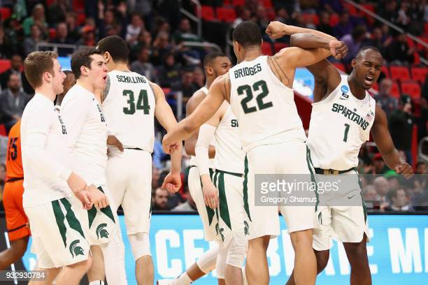 Joshua Langford celebrates with Miles Bridges of the Michigan State Spartans during the first half against the Bucknell Bison in the first round of...