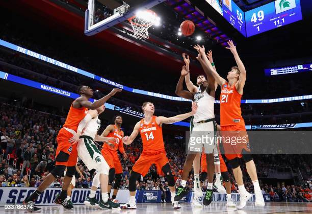 Joshua Langford of the Michigan State Spartans and Marek Dolezaj of the Syracuse Orange battle for the ball during the second half in the second...