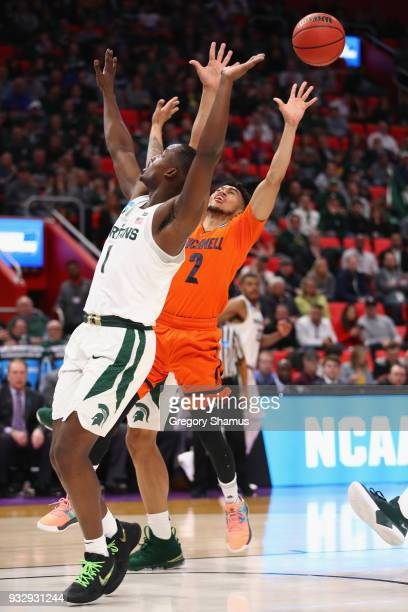 Joshua Langford of the Michigan State Spartans and Stephen Brown of the Bucknell Bison battle for the ball during the first half in the first round...