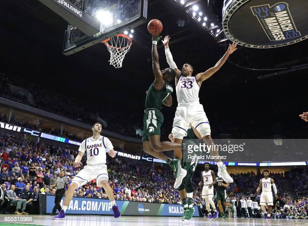 Joshua Langford of the Michigan State Spartans attempts a shot defended by Landen Lucas of the Kansas Jayhawks during the second round of the 2017...
