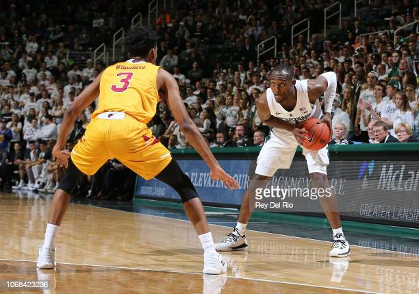 Joshua Langford of the Michigan State Spartans handles the ball while defended by JD Williams of the Louisiana Monroe Warhawks in the first half at...