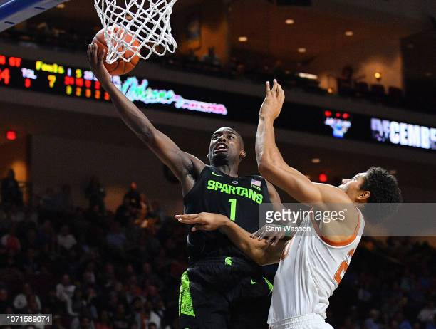 Joshua Langford of the Michigan State Spartans shoots against Jericho Sims of the Texas Longhorns during the championship game of the 2018...