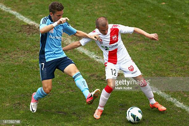 Joshua MacDonald of Sydney FC and Philip Petreski of the Heart compete for the ball during the round seven Youth League match between Sydney FC and...