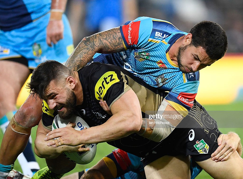 Joshua Mansour of the Panthers is tackled by Nathan Peats of the Titans during the round 25 NRL match between the Gold Coast Titans and the Penrith Panthers at Cbus Super Stadium on August 27, 2016 in Gold Coast, Australia.