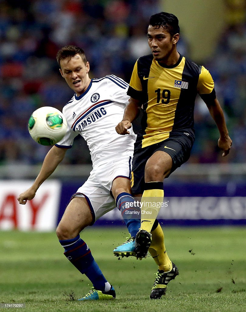 Joshua Mark Mceschran of Chelsea battles with Mohd Norfarhan of Malaysia during the match between Chelsea and Malaysia XI on July 21, 2013 at the Shah Alam Stadium in Shah Alam in Kuala Lumpur, Malaysia.