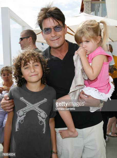MALIBU CA AUGUST 25 Joshua Marks Actor Charlie Sheen and daughter Sam Sheen attend the French Connection's Kids connection to benefit The Art Of...