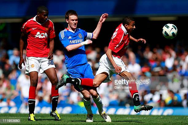 Joshua McEachran of Chelsea in action against Jesse Lingard of Manchester United during the FA Youth Cup sponsored by Eon semi final first leg match...