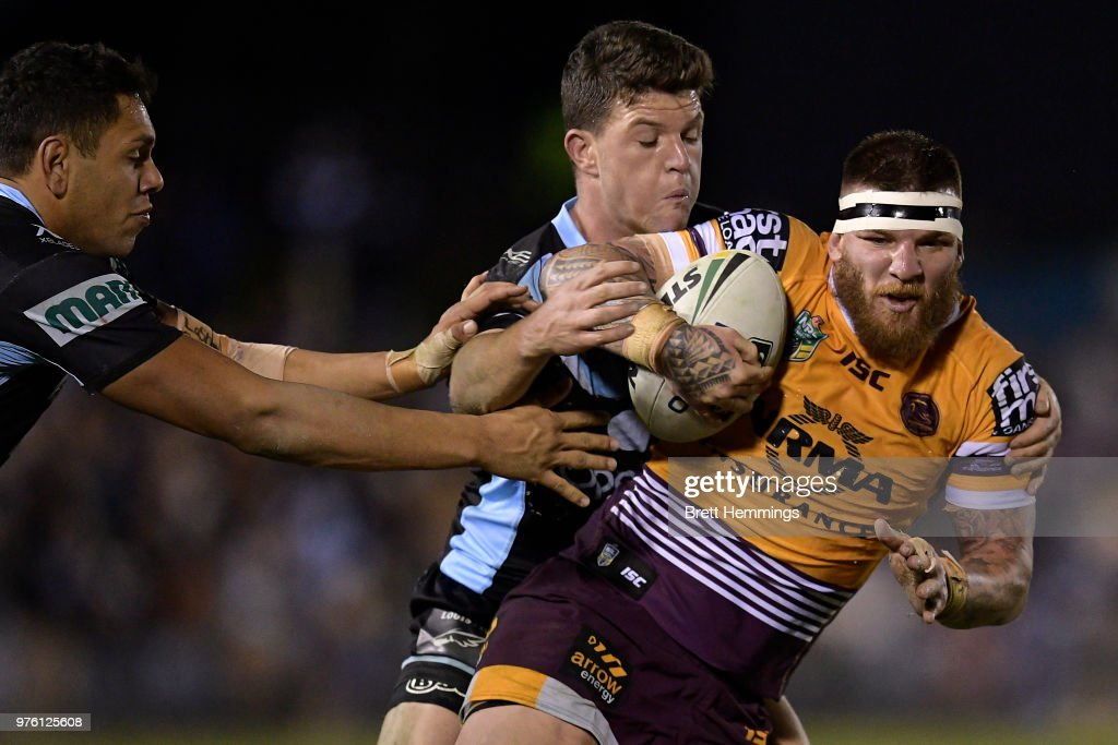 Joshua McGuire of the Broncos is tackled during the round 15 NRL match between the Cronulla Sharks and the Brisbane Broncos at Southern Cross Group Stadium on June 16, 2018 in Sydney, Australia.