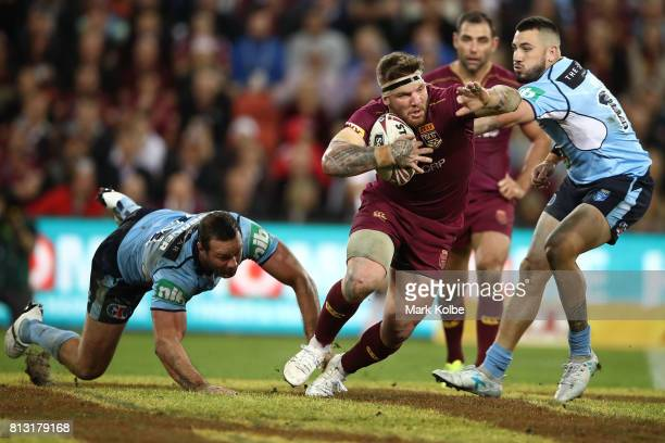 Joshua Mcguire of the Maroons is tackled during game three of the State Of Origin series between the Queensland Maroons and the New South Wales Blues...