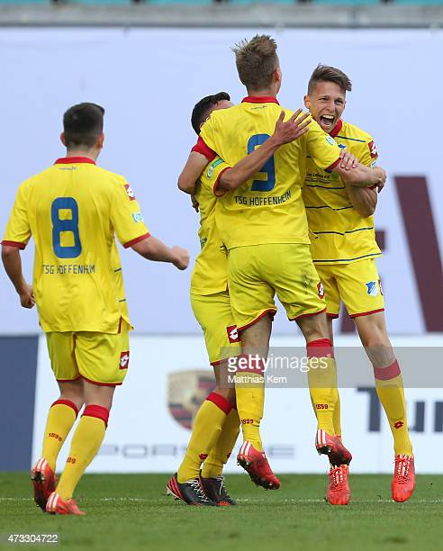 Joshua Mees of Hoffenheim jubilates with team mates after scoring the fourth goal during the U19 A Juniors Bundesliga semi final match between RB...