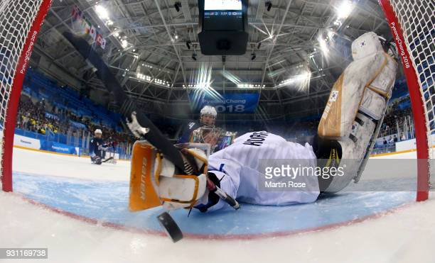 Joshua Misiewicz of United States scores a goal in the Ice Hockey Preliminary Round Group B game between United States and Korea during day four of...