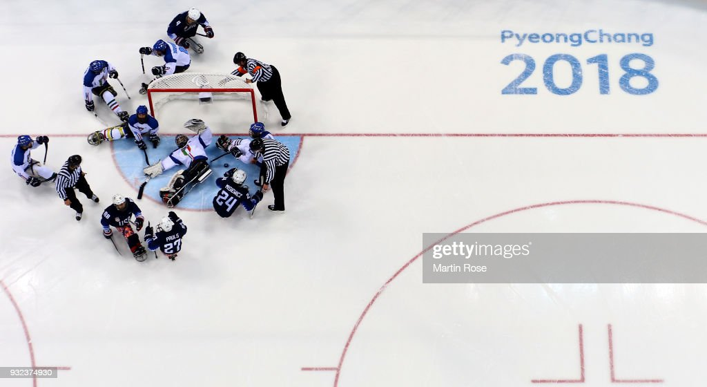 Joshua Misiewicz#24 of United States scores over Gabriele Araudo, goaltender of Italy in the Ice Hockey semi final game between United States and Italy during day six of the PyeongChang 2018 Paralympic Games on March 15, 2018 in Gangneung, South Korea.