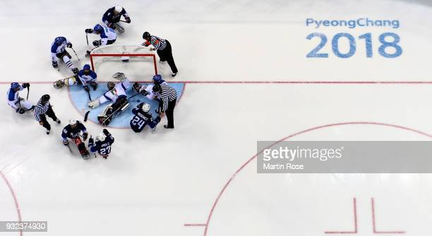 Joshua Misiewicz#24 of United States scores over Gabriele Araudo goaltender of Italy in the Ice Hockey semi final game between United States and...