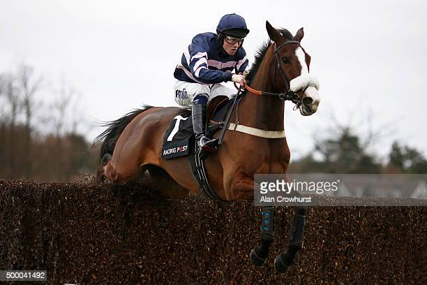 Joshua Moore riding Ar Mad clear the last to win The Racing Post Henry VIII Novices' Steeple Chase at Sandown racecourse on December 05 2015 in Esher...