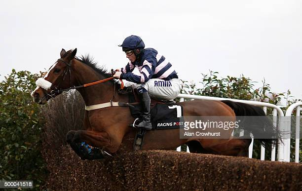 Joshua Moore riding Ar Mad on their way to winning The Racing Post Henry VIII Novices' Steeple Chase at Sandown racecourse on December 05 2015 in...