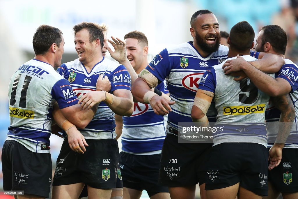 Joshua Morris of the Bulldogs celebrates with team mates after scoring a try during the round 25 NRL match between the Gold Coast Titans and the Canterbury Bulldogs at Cbus Super Stadium on August 26, 2017 in Gold Coast, Australia.