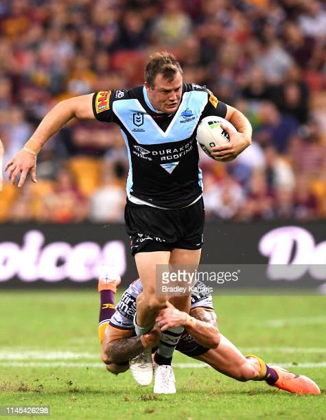 Joshua Morris of the Sharks attempts to break free from the defence during the round 7 NRL match between the Brisbane Broncos and the...