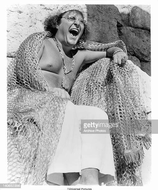 Joshua Mostel roars with laughter as orders are issued to flog Jesus in a scene from the film 'Jesus Christ Superstar', 1973.
