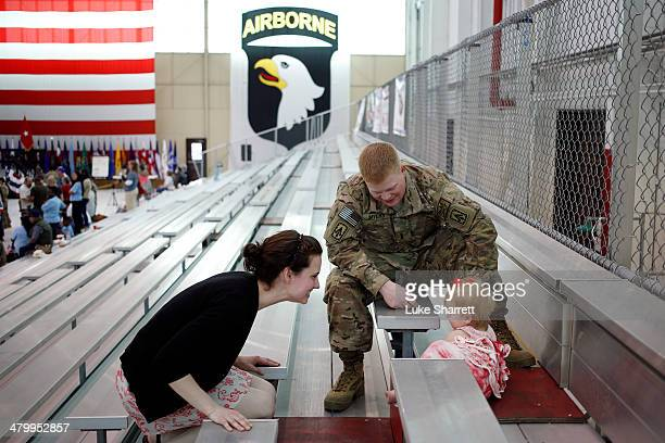 Joshua Myers of the US Army's Battery B 2nd Battalion 44th Air Defense Artillery Regiment 101st Airborne Division and his wife Corynn Myers play with...