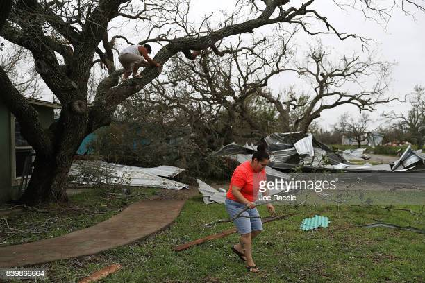 Joshua Nguyen and Deserae Garcia clean up around their home after Hurricane Harvey passed through on August 27 2017 in Rockport Texas Harvey made...