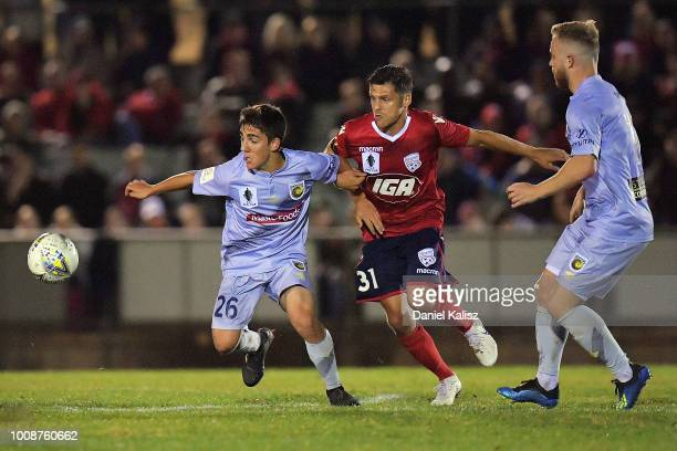 Joshua Nisbet of the Mariners and Mirko Boland of United compete for the ball during the round of 32 FFA Cup match between Adelaide United and the...