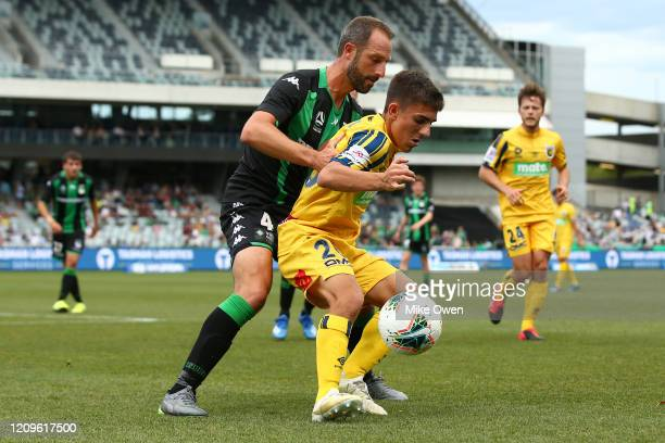 Joshua Nisbet of the Mariners under pressure from Andrew Durante of Western United during the round 21 ALeague match between Western United and the...