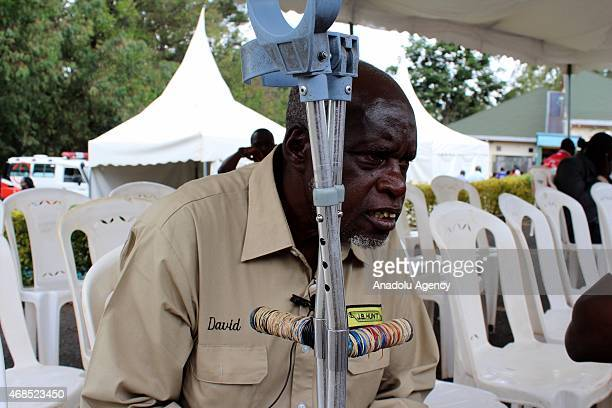 Joshua Nzeya waits in front of the morgue of Chiromo Campus of Nairobi University to identify the corps of his son killed during the AlShabaab...