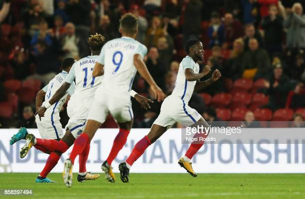 Joshua Onomah of England celebrates as he scores their first goal with team mates during the UEFA European Under 21 Championship Group 4 Qualifier...