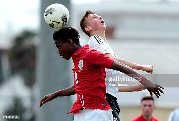 Joshua Onomah of England challenges Ole Kauper of Germany during the Under17 Algarve Cup between U17 England and U17 Germany at Lagos sport complex...