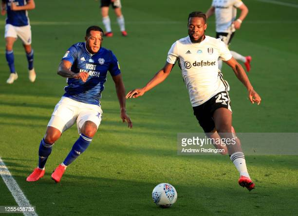 Joshua Onomah of Fulham is challenged by Nathaniel MendezLaing of Cardiff City during the Sky Bet Championship match between Fulham and Cardiff City...