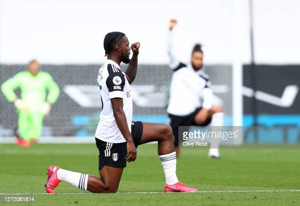 Joshua Onomah of Fulham takes a knee in support of the Black Lives Matter movment prior to the Premier League match between Fulham and Arsenal at...