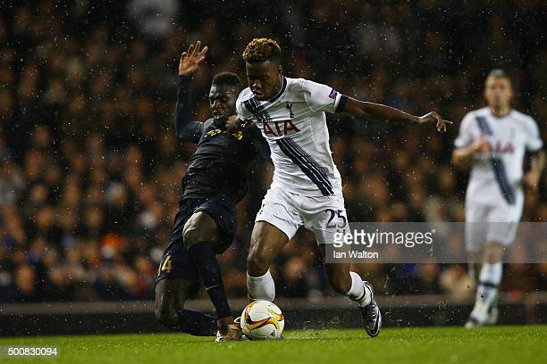 Joshua Onomah of Spurs is challenged by Tiemoue Bakayoko of Monaco during the UEFA Europa League Group J match between Tottenham Hotspur and AS...