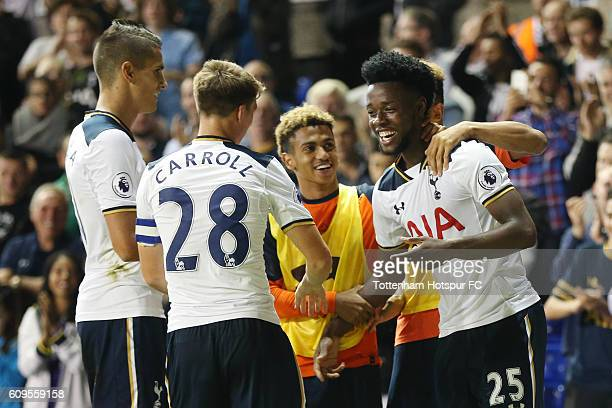 Joshua Onomah of Tottenaham Hotspur celebrates scoring his sides fourth goal with team mates during the EFL Cup Third Round match between Tottenham...