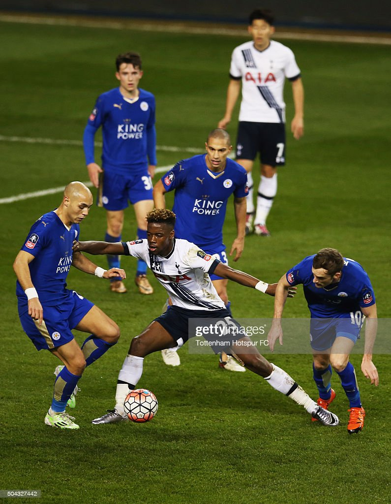 Joshua Onomah of Tottenham Hotspur battles with Andy King, Yohan Benalouan and Gokhan Inler of Leicester City during the Emirates FA Cup third round match between Tottenham Hotspur and Leicester City at White Hart Lane on January 10, 2016 in London, England.