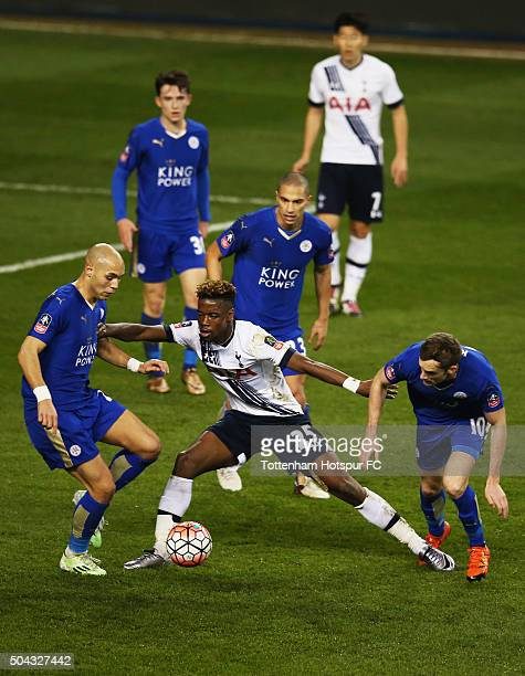 Joshua Onomah of Tottenham Hotspur battles with Andy King Yohan Benalouan and Gokhan Inler of Leicester City during the Emirates FA Cup third round...
