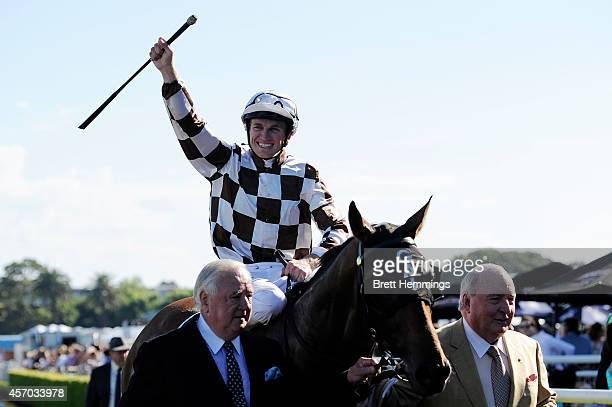 Joshua Parr celebrates his winning ride on Hampton Court to win the Moet and Chandon Spring Champion Stakes during Spring Stakes Day at Royal...