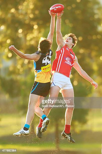 Joshua Patullo of the Gippsland Power and Nick Cottrell of the Bendigo Pioneers compete for the ball during the round 11 TAC Cup match between...