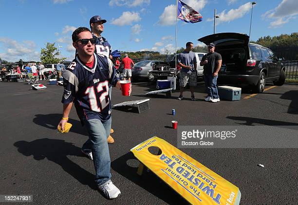 Joshua Pelletier, of Haverhill, Mass., tosses the beanbag as he tailgates before the New England Patriots play the Arizona Cardinals at Gillette...
