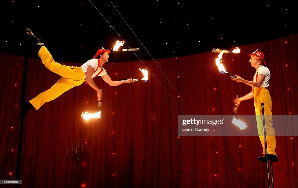 Joshua Phillips and Idris Stanton perform fire juggling on poles and ladders as graduates perform at the National Institute of Circus Arts on December 2, 2009 in Melbourne, Australia.