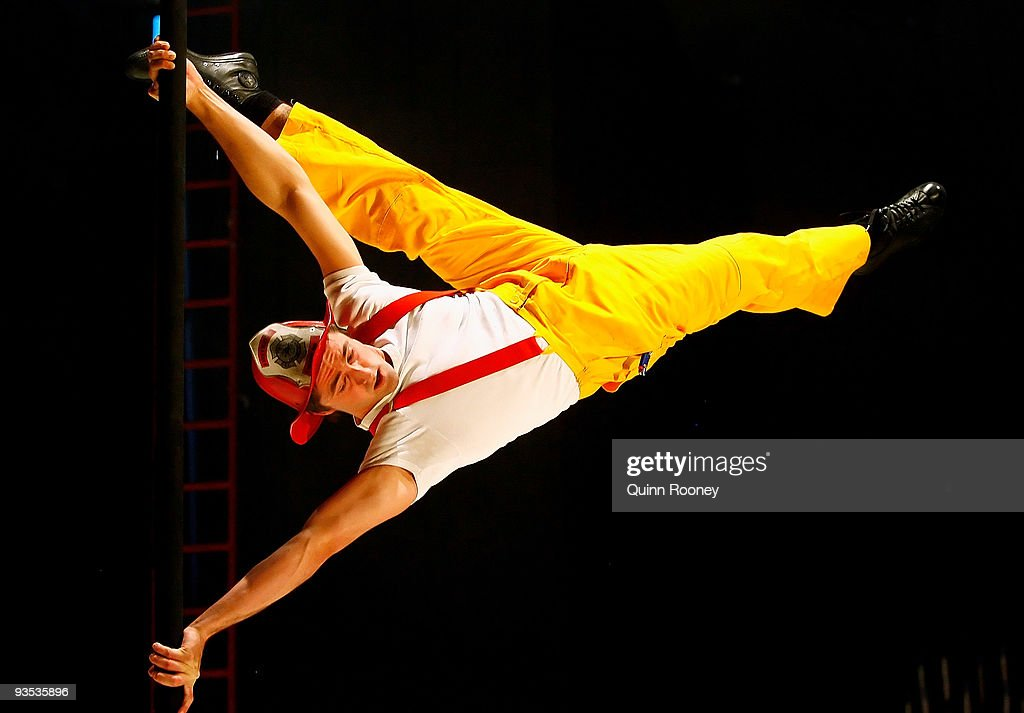 Joshua Phillips performs on the pole as graduates perform at the National Institute of Circus Arts on December 2, 2009 in Melbourne, Australia.