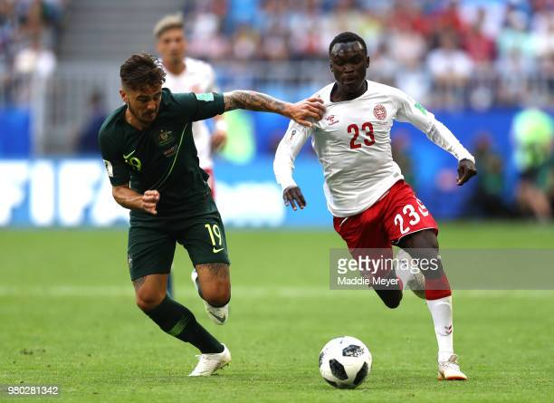 Joshua Risdon of Australia battles for possession with Pione Sisto of Denmark during the 2018 FIFA World Cup Russia group C match between Denmark and...