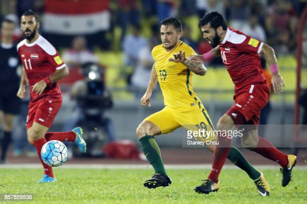 Joshua Risdon of Australia holds off Tamer Hag Mohamad of Syria during the 2018 FIFA World Cup Asian Playoff match between Syria and the Australia...