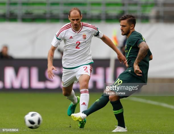 Joshua Risdon of Australia passes the ball next to Janos Szabo of Hungary during the International Friendly match between Hungary and Australia at...