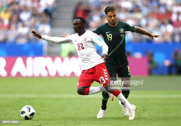 Joshua Risdon of Australia tackles Pione Sisto of Denmark during the 2018 FIFA World Cup Russia group C match between Denmark and Australia at Samara...