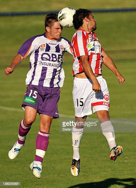 Joshua Risdon of the Glory and David Williams of the Heart contest the ball during the round nine Youth League match between the Perth Glory and the...