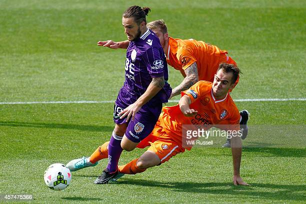 Joshua Risdon of the Glory is tackled by Steven Lustica of the Roar during the round two A-League match between the Perth Glory and Brisbane Roar at...