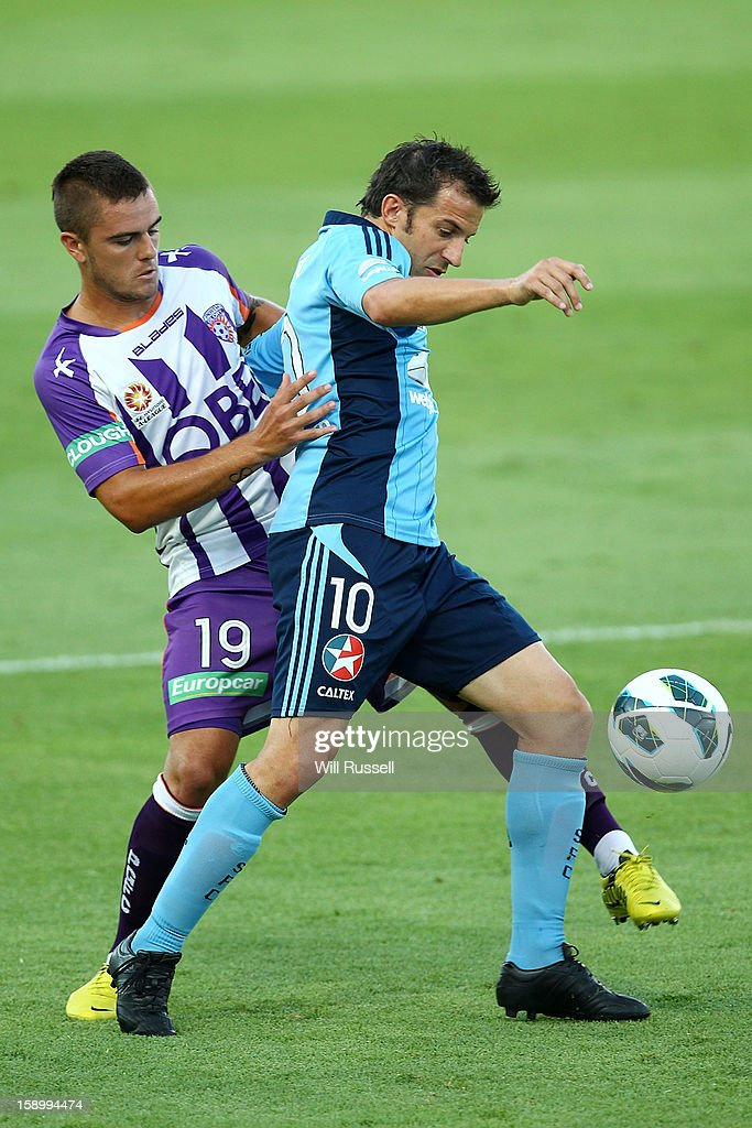 Joshua Risdon of the Glory tackles Alessandro Del Piero of Sydney during the round 15 A-League match between the Perth Glory and Sydney FC at nib Stadium on January 5, 2013 in Perth, Australia.