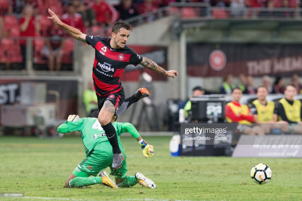 Joshua Risdon of the Wanderers gets past Phoenix's goalkeeper Tando Velaphi to set up Christopher Ikonomidis's goal during the round 22 A-League match between the Western Sydney Wanderers and the Wellington Phoenix at Spotless Stadium on March 10, 2018 in Sydney, Australia.