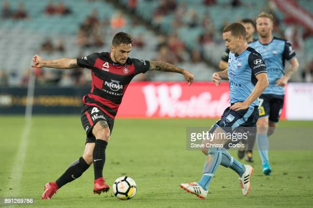 Joshua Risdon of the Wanderers is tackled by Sydney FC's Brandon O'Neill during the round ten ALeague match between the Western Sydney Wanderers and...